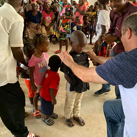 Joe Amaral and Hope for Liberia giving out clothing to children in village